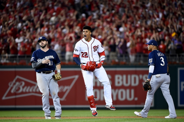 WASHINGTON, DC - OCTOBER 01: Juan Soto #22 of the Washington Nationals celebrates after hitting a single to right field to score 3 runs off of an error by Trent Grisham #2 of the Milwaukee Brewers during the eighth inning in the National League Wild Card game at Nationals Park on October 01, 2019 in Washington, DC. (Photo by Will Newton/Getty Images)