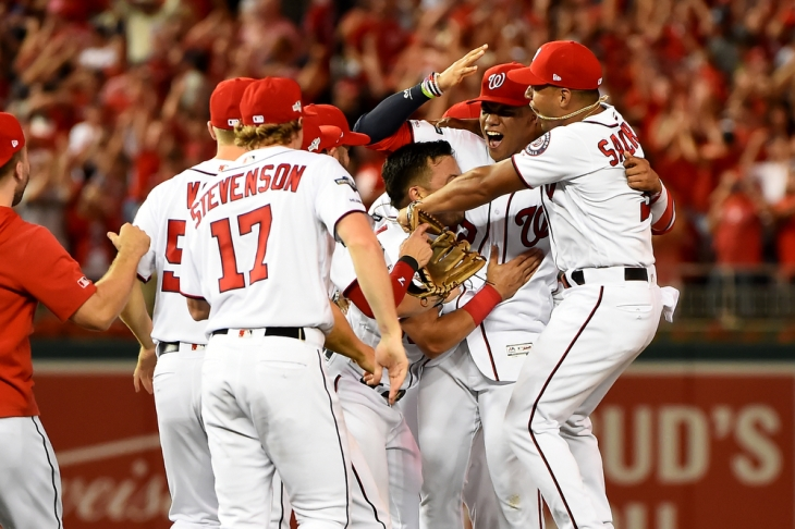 WASHINGTON, DC - OCTOBER 01: Juan Soto #22 of the Washington Nationals celebrates with teammates after defeating the Milwaukee Brewers for the National League Wild Card game at Nationals Park on October 1, 2019 in Washington, DC. (Photo by Will Newton/Getty Images)