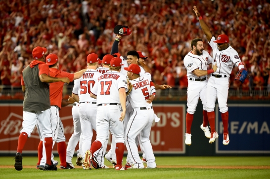 WASHINGTON, DC - OCTOBER 01: The Washington Nationals celebrate after defeating the Milwaukee Brewers for the National League Wild Card game at Nationals Park on October 1, 2019 in Washington, DC. (Photo by Will Newton/Getty Images)