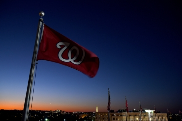 WASHINGTON, DC - OCTOBER 14: A Washington Nationals flag flies at the top of Nationals Park prior to Game Three of the National League Championship Series between the Washington Nationals and the St. Louis Cardinals at Nationals Park on October 14, 2019 in Washington, DC. (Photo by Will Newton/Getty Images)
