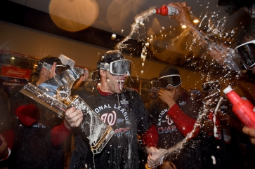 WASHINGTON, DC - OCTOBER 15: Patrick Corbin #46 of the Washington Nationals celebrates with teammates after defeating the St. Louis Cardinals for Game Four of the National League Championship Series at Nationals Park on October 15, 2019 in Washington, DC. (Photo by Will Newton/Getty Images)