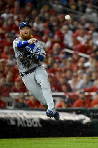 WASHINGTON, DC - OCTOBER 07: Justin Turner #10 of the Los Angeles Dodgers throws to first base against the Washington Nationals in Game Four of the National League Division Series at Nationals Park on October 7, 2019 in Washington, DC. (Photo by Will Newton/Getty Images)