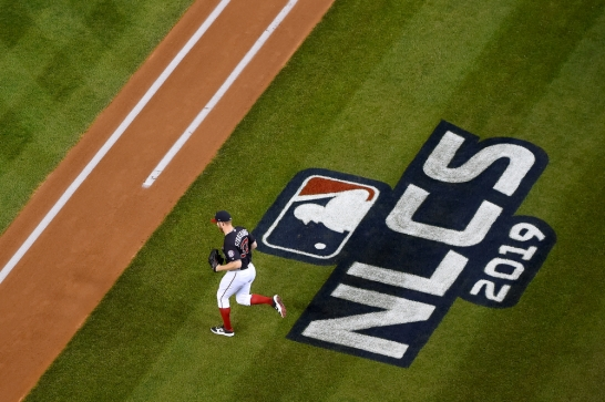 WASHINGTON, DC - OCTOBER 14: Stephen Strasburg #37 of the Washington Nationals runs on to the field to pitch against the St. Louis Cardinals during Game Three of the National League Championship Series at Nationals Park on October 14, 2019 in Washington, DC. (Photo by Will Newton/Getty Images)