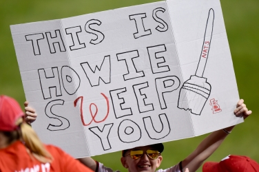 WASHINGTON, DC - OCTOBER 15: A fan holds a sign during Game Four of the National League Championship Series between the Washington Nationals and the St. Louis Cardinals at Nationals Park on October 15, 2019 in Washington, DC. (Photo by Will Newton/Getty Images)