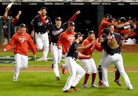 WASHINGTON, DC - OCTOBER 15: Daniel Hudson #44 of the Washington Nationals and Yan Gomes #10 celebrate with teammates after defeating the St. Louis Cardinals to win Game Four of the National League Championship Series at Nationals Park on October 15, 2019 in Washington, DC. (Photo by Will Newton/Getty Images)