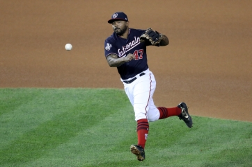 WASHINGTON, DC - OCTOBER 27: Howie Kendrick #47 of the Washington Nationals throws to first base against the Houston Astros during Game Five of the 2019 World Series at Nationals Park on October 27, 2019 in Washington, DC. (Photo by Will Newton/Getty Images)