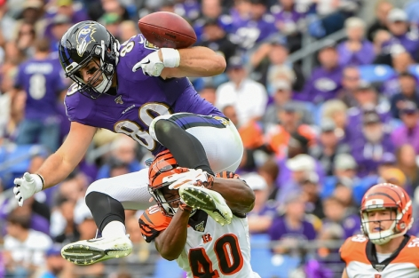 BALTIMORE, MD - OCTOBER 13: Mark Andrews #89 of the Baltimore Ravens fumbles the football trying to leap over Brandon Wilson #40 of the Cincinnati Bengals during the first half at M&T Bank Stadium on October 13, 2019 in Baltimore, Maryland. (Photo by Will Newton/Getty Images)