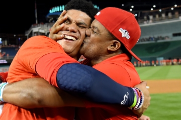 WASHINGTON, DC - OCTOBER 01: Juan Soto #22 of the Washington Nationals celebrates with his father after defeating the Milwaukee Brewers in the National League Wild Card game at Nationals Park on October 1, 2019 in Washington, DC. (Photo by Will Newton/Getty Images)