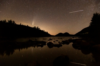 ACADIA NATIONAL PARK, ME - JULY 21: Comet NEOWISE (L) and the International Space Station (R), with five crew members on board, pass over Jordan Pond in Acadia National Park, ME on July 21, 2020. (Photo by Will Newton/Friends of Acadia)