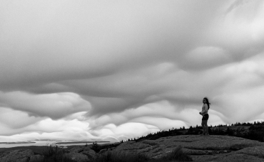 ACADIA NATIONAL PARK, ME - AUGUST 4: A young park visitor looks on from the summit of Cadillac as tropical storm Isaias brings wind and clouds to Acadia National Park, ME on August 4, 2020. (Photo by Will Newton/Friends of Acadia)