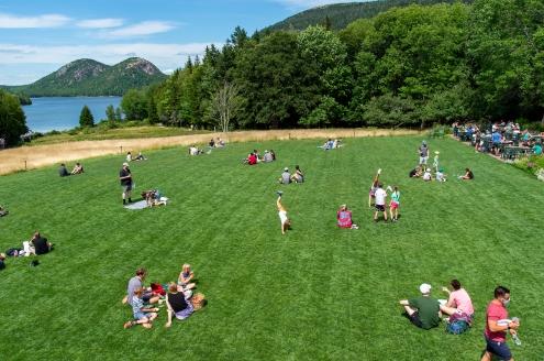 ACADIA NATIONAL PARK, ME - AUGUST 6: Park visitors enjoy the Tea Lawn of Jordan Pond House in Acadia National Park, ME on August 6, 2020. (Photo by Will Newton/Friends of Acadia)