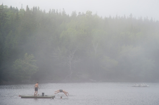 ISLE AU HAUT, ME - AUGUST 11: A family enjoys swimming on Long Pond on Isle au Haut, ME on August 11, 2020. (Photo by Will Newton/Friends of Acadia)