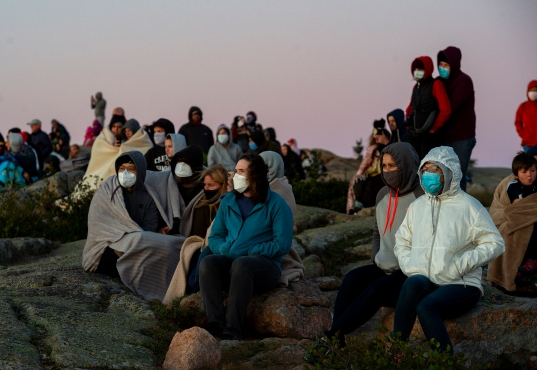 ACADIA NATIONAL PARK, ME - AUGUST 27: Park visitors await the sunrise from the summit of Cadillac mountain in Acadia National Park, ME on August 27, 2020. (Photo by Will Newton/Friends of Acadia)