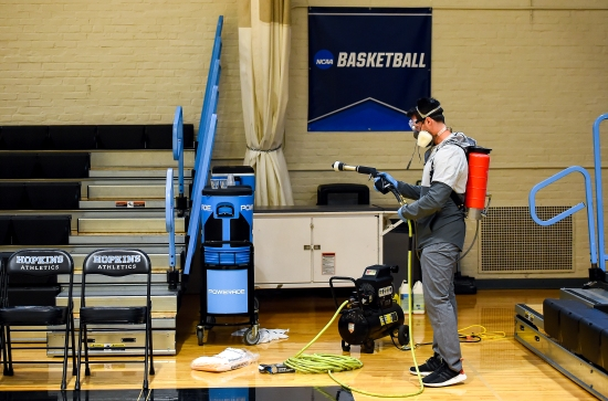 BALTIMORE, MD - MARCH 6: Taylor Michel, Director of Operations of Disinfection Technologies Group, prepares to disinfect the arena after the game between Yeshiva and WPI at Johns Hopkins University in Baltimore, MD on March 6, 2020. (Photo by Will Newton for The Washington Post)