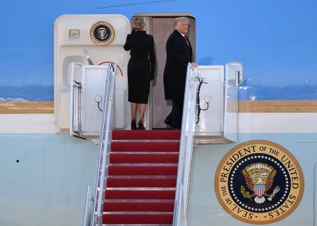 SUITLAND, MD - JANUARY 20: President Donald Trump looks back as he and First Lady Melania Trump board Air Force One at Joint Base Andrews in Suitland, MD on January 20, 2021. (Photo by Will Newton for The Washington Post)