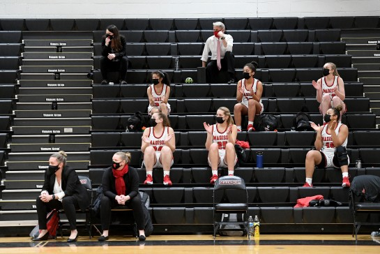 VIENNA, VA - FEBRUARY 20: The Madison bench cheers during the second half against Osbourn Park at James Madison High School in Vienna, VA on February 20, 2021. (Photo by Will Newton for The Washington Post)