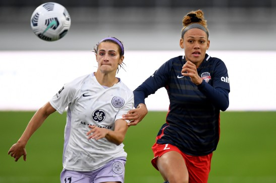 Racing Louisville FC defender Emily Fox (11) and Washington Spirit forward Trinity Rodman (2) battle for the ball during an NWSL Challenge Cup soccer match, Thursday, April 15, 2021, in Washington. (AP Photo/Will Newton)