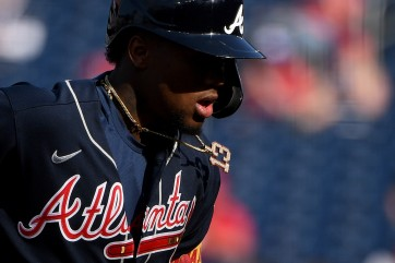 202104061716WN - Ronald Acuna Jr. #13 of the Atlanta Braves rounds the bases after hitting a home run during