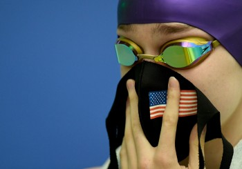STAFFORD, VA - FEBRUARY 25: Camille Spink of Battlefield holds a protective mask on her face prior to competing during the Virginia Class 6 Swimming Finals at the Jeff Rouse Swim and Sport Center in Stafford, VA on February 25, 2021. (Photo by Will Newton for The Washington Post)