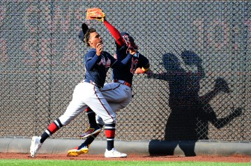 202104061716WN - Cristian Pache #25 and Ronald Acuna Jr. #13 of the Atlanta Braves collide in the outfield during